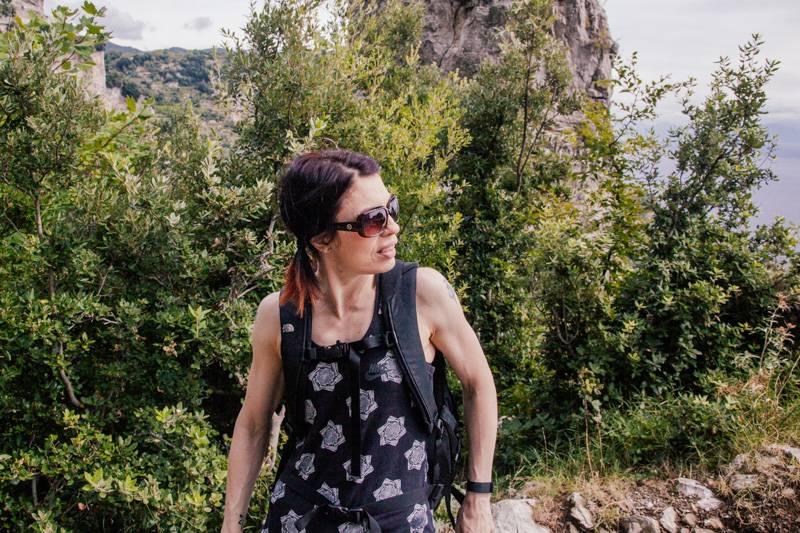 Female hiker wearing sunglasses and a rucksack, Sentiero degli Dei