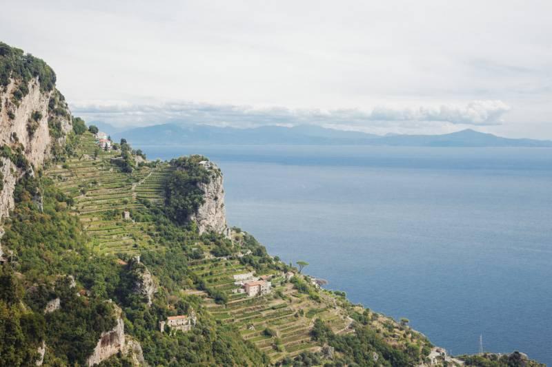 View of lemon groves and the sea. Amalfi Coast, Italy.