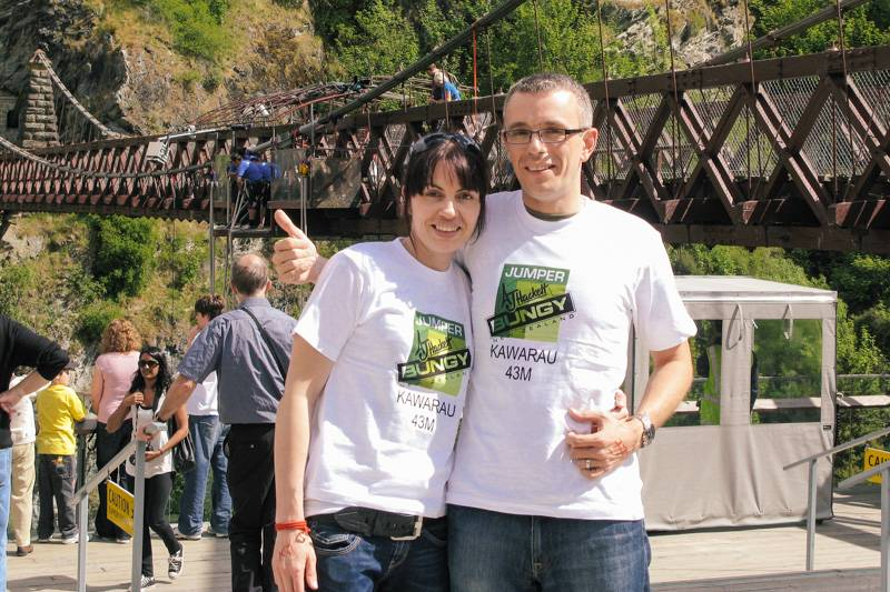 Man and woman posing, after doing a bungy jump with AJ Hackett in Queenstown