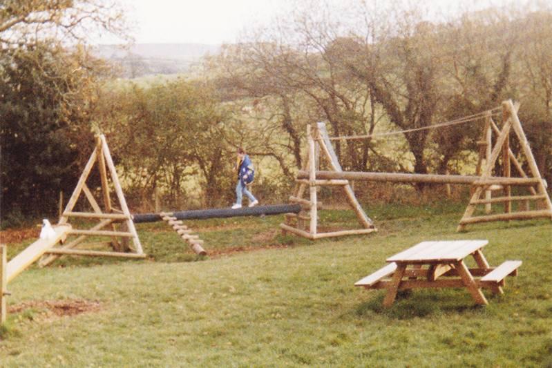 Girl on outdoor climbing frame