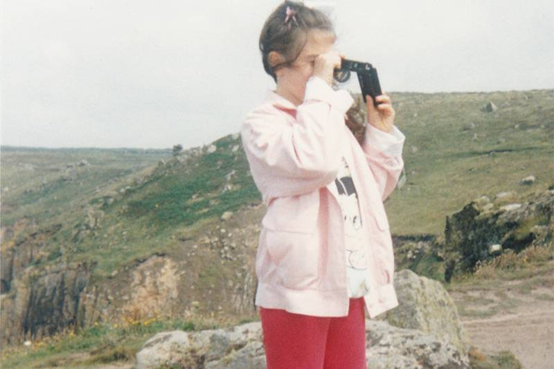 Young girl taking a photo