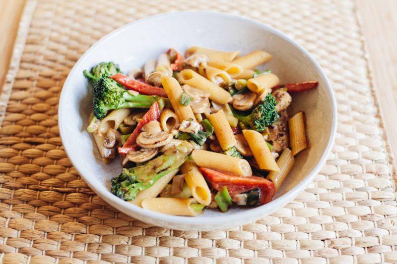 Healthy vegan pasta dish with peanut sauce