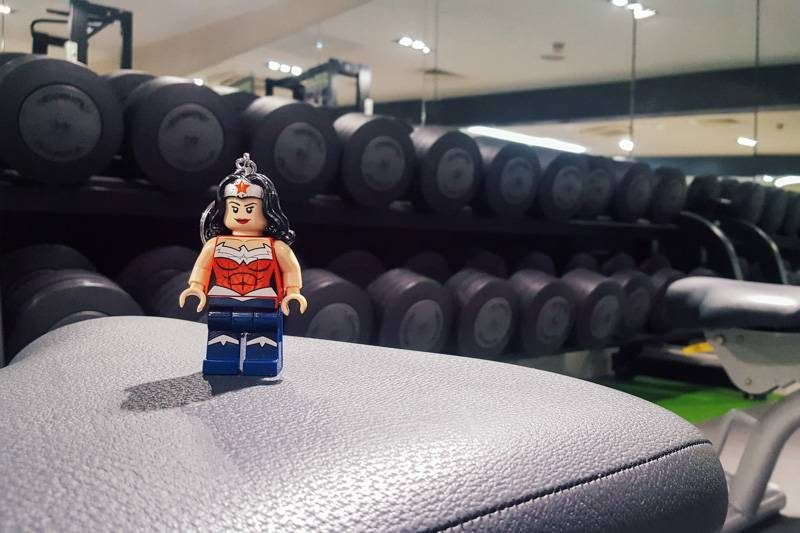 Wonder Woman lifting weights