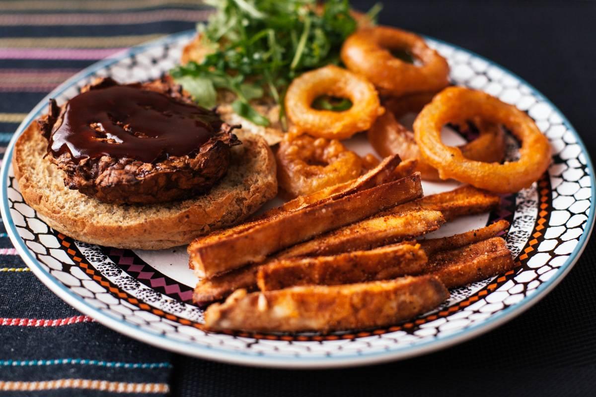 Vegan pulled pork burger, sweet potato fries and onion rings