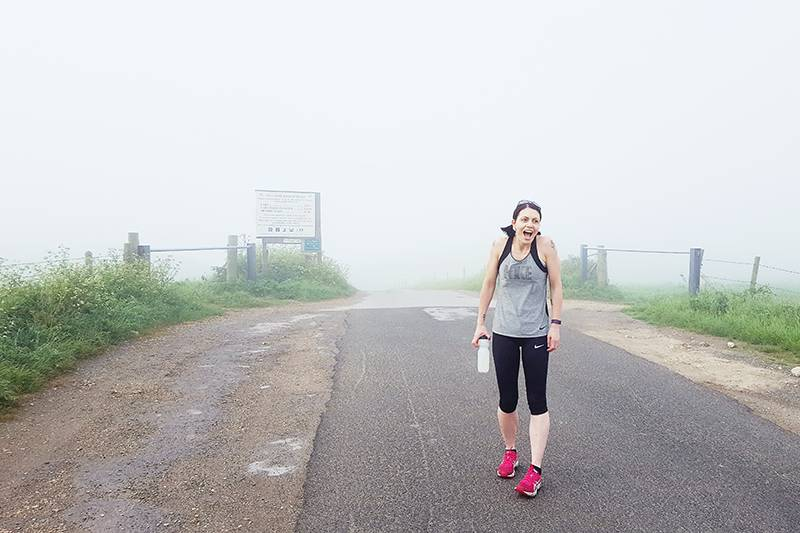 Female runner in the mist
