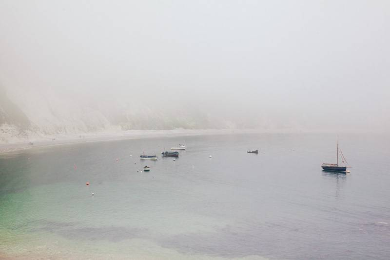 Lulworth Cove covered in mist
