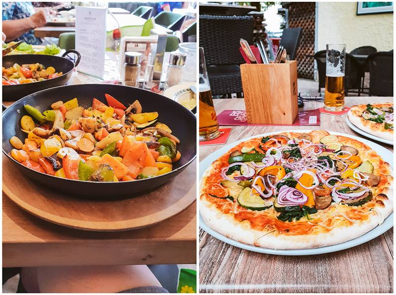 Vegan food, including a bowl of roasted vegetables and a pizza