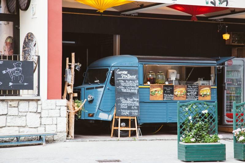 Blue food truck in Wolfgangsee, Austria