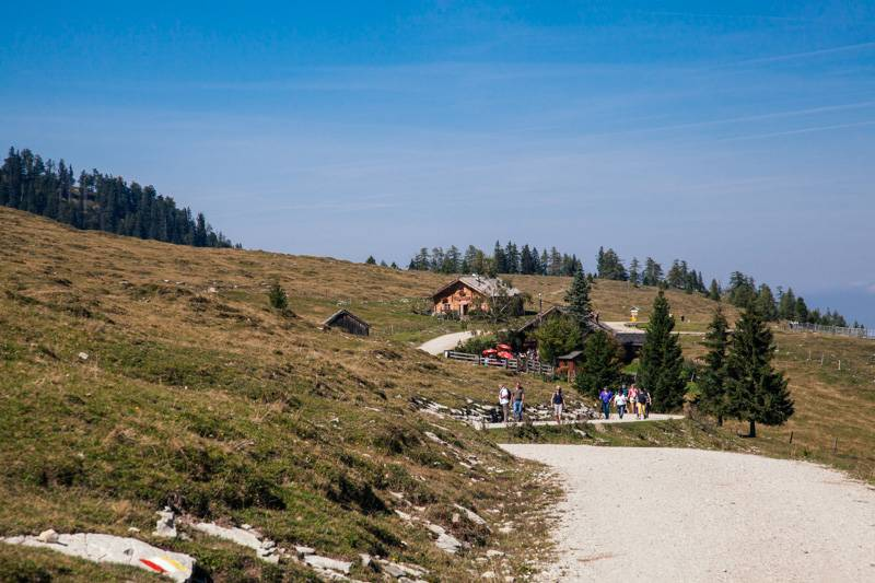 People walking on a pathway in the mountains in Postalm, Austria