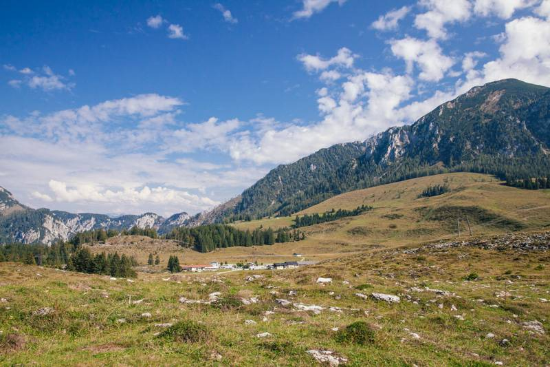Mountains, blue sky with clouds and rocky hillside in Postalm, Austria