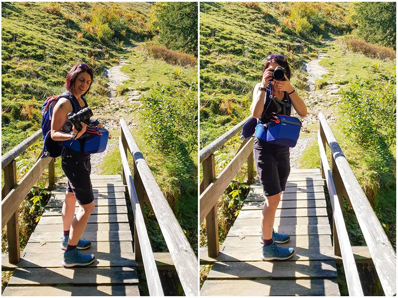 Woman with camera on a wooden bridge in Postalm, Austria