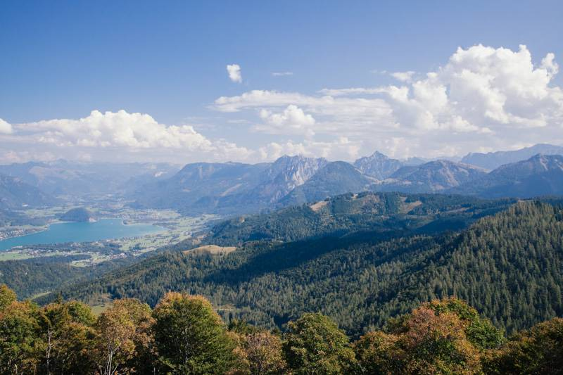 View of forest, mountains and Lake Wolfgang from the top of Zwölferhorn mountain, Austria