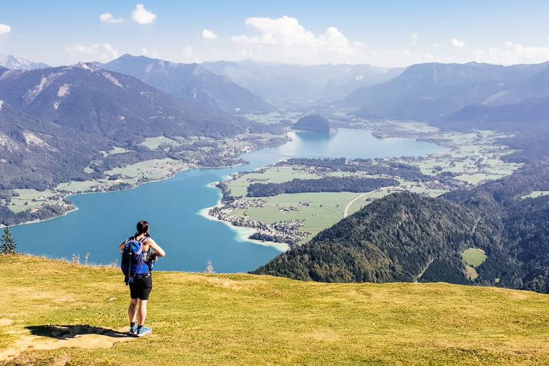 Woman stood on a mountain looking over Wolfgangsee in Austria