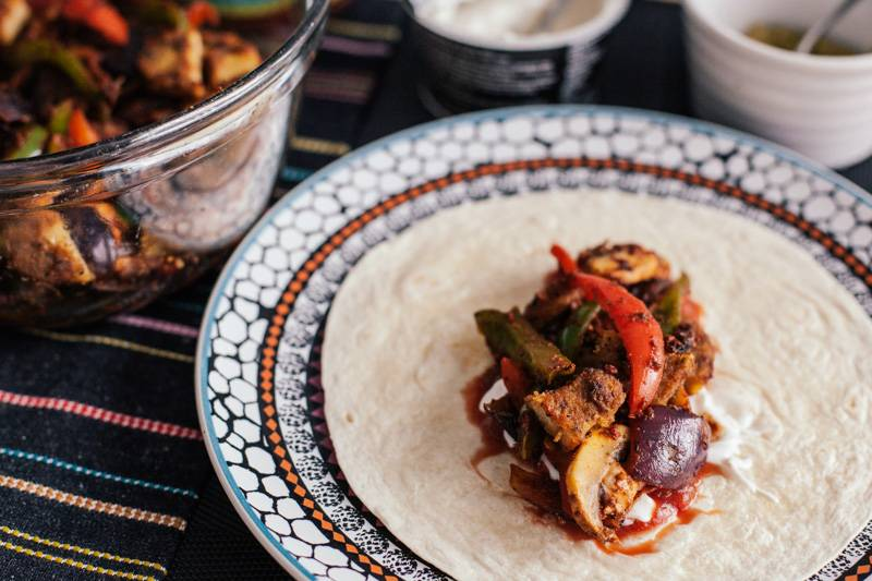 Vegan fajitas on a colourful plate